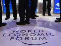 FILE: A WEF logo sits on the stage as panelists talk ahead of a panel session at the World Economic Forum (WEF) in Davos, Switzerland, on Friday, Jan. 22, 2016. President Donald Trump will dominate the Davos forum as no U.S. leader has before: a provocateur-in-chief practiced at tweaking the …