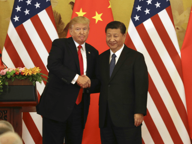 U.S. President Donald Trump (L) and Chinese President Xi Jinping shake hands at a joint news conference held after their meeting in Beijing on Nov. 9, 2017. The two leaders agreed to keep enforcing U.N. sanctions on North Korea until it rids itself of nuclear weapons while pledging to address the billowing U.S. trade deficit with China. (Kyodo) ==Kyodo (Photo by Kyodo News via Getty Images)