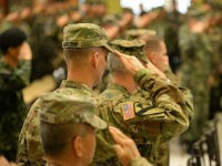 US soldiers salute as their national anthem is played during the opening ceremony of the annual joint 11-day Balikatan (Shoulder-to-Shoulder) military exercise in Manila on April 4, 2016. US and Philippine troops began major exercises on April 4 as China's state media warned 'outsiders' against interfering in tense South China Sea territorial disputes. / AFP / TED ALJIBE (Photo credit should read TED ALJIBE/AFP/Getty Images)