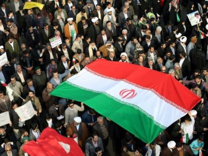 Iranians rally in support of the government in the city of Mashhad on January 4, 2018, after authorities declared an end to days of deadly unrest sparked by economic concerns