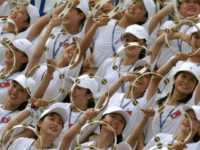 North Korean cheerleaders make a wave during their team's women's football match against Germany, in Gimcheon, in 2003
