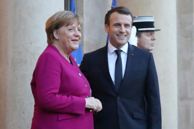 French president Emmanuel Macron welcomes German Chancellor Angela Merkel at the Elysee Palace in Paris