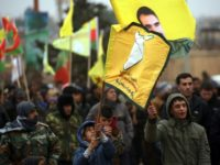 Syrian-Kurds march in the northern Syrian town of Jawadiyah during a protest in support of the Afrin region controlled by the Kurdish People's Protection Units (YPG) militia