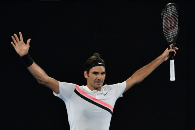 Switzerland's Roger Federer celebrates beating France's Richard Gasquet in their men's singles third round match on day six of the Australian Open tennis tournament in Melbourne on January 20, 2018