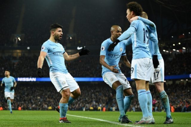 Manchester City's striker Sergio Aguero (2nd L) celebrates with teammates after scoring his and Manchester City's third goal during the English Premier League football match against Newcastle United January 20, 2018
