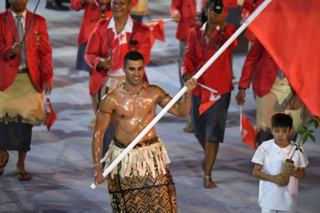 Tonga's oiled flagbearer qualifies for Winter Olympics