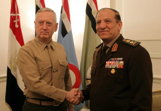 Former Egyptian armed forces chief of staff Sami Anan (R), who has announced he will challenge President Abdel Fattah al-Sisi in a March election, meets then US Central Command chief now Defence Secretary James Mattis in Cairo on March 29, 2011