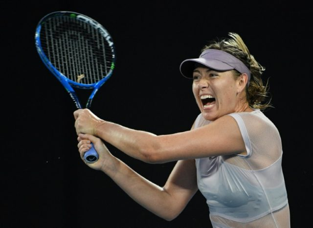 Russia's Maria Sharapova hits a return against Germany's Angelique Kerber during their women's singles match at the Australian Open in Melbourne on January 20, 2018