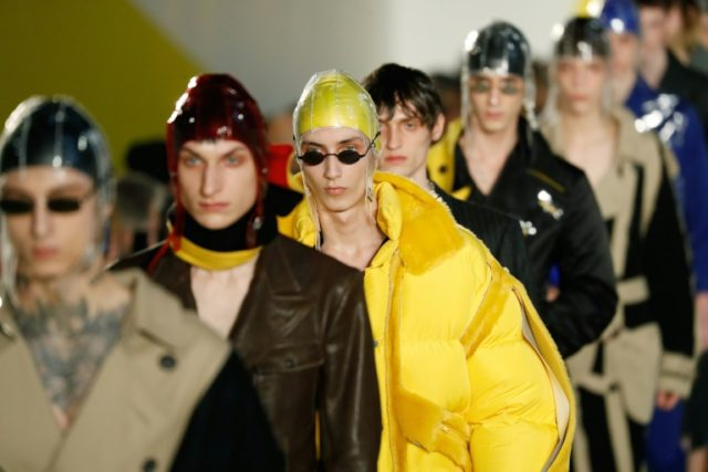 Models present creations by Margiela during the men's Fashion Week in Paris.