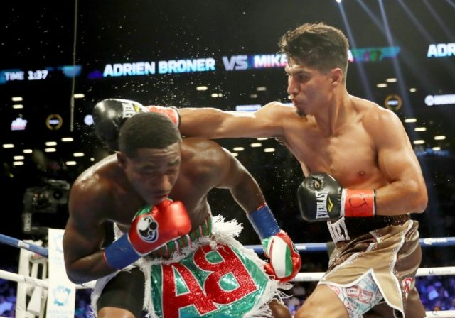 Mikey Garcia punches Adrien Broner during their Junior Welterwight bout in July 2017 in Brooklyn