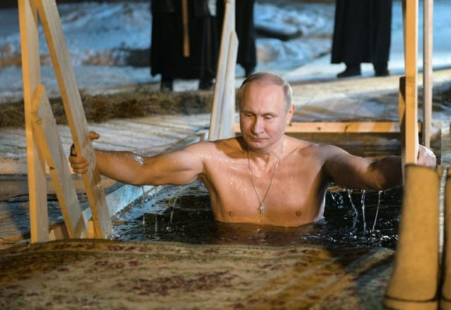 Icing it: Russia's Vladimir Putin plunges into the frozen waters of Lake Seliger in a traditional rite to mark Epiphany