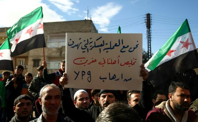 Syrians demonstrate in support of a joint rebel and Turkish military operation against Syrian-Kurdish forces in the town of Afrin