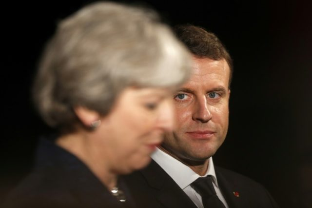 """French President Emmanuel Macron (R), seen here next to British Prime Minister Theresa May, said he regretted the Brexit vote and """"would love to welcome"""" the UK back"""