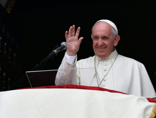 Pope Francis waves to the crowd gathered at Plaza de Armas square in Lima at the end of his Angelus prayer