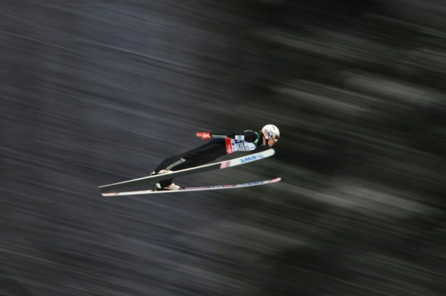 Daniel Andre Tande soars through the air at the ski-flying world championships in southern Germany, on January 21, 2018