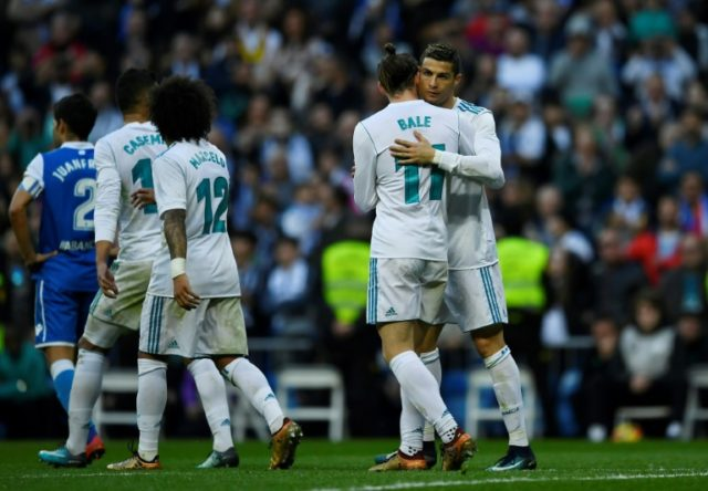 Real Madrid defy crisis talk as Barcelona extend lead