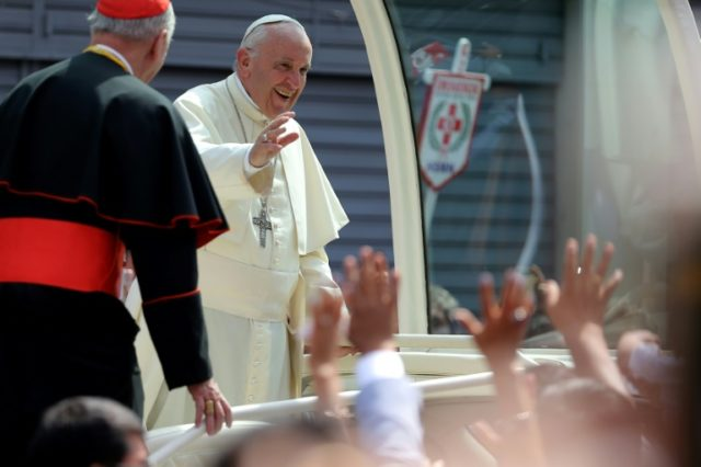 Pope Francis smiles at the crowd from the popemobile as he leaves the Senor de los Milagros Sanctuary in Lima, after a private meeting with contemplative nuns, on January 21, 2018, the final day of a visit to Peru and Chile