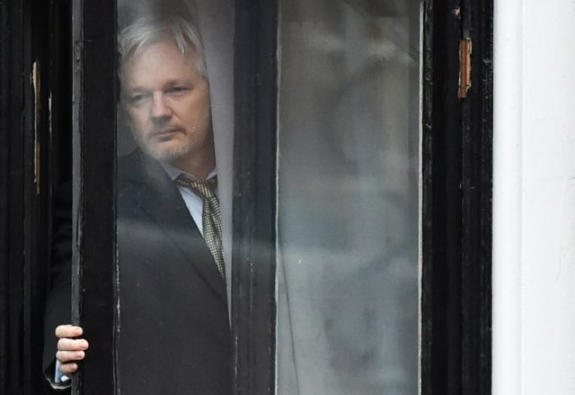 WikiLeaks founder Julian Assange on the balcony of the Ecuadorian embassy in London