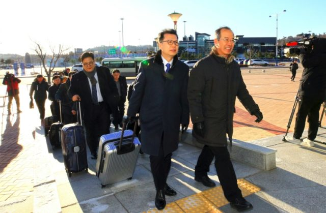 A South Korea delegation arrives at the inter-Korea transit office near the Demilitarized Zone (DMZ) dividing the two Koreas in Goseong to cross into the North to inspect venues for joint pre-Olympic events