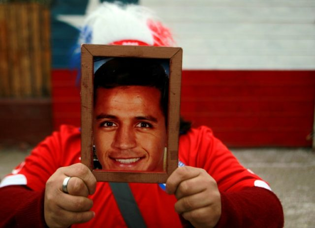 A Chilean fan holds the portrait of Alexis Sanchez