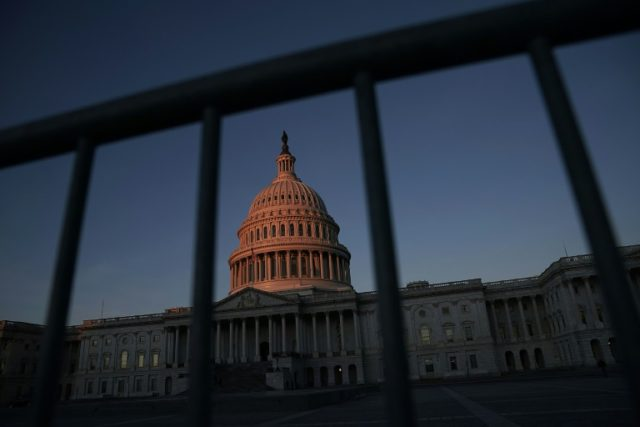 US government workers home without pay as shutdown impasse drags on