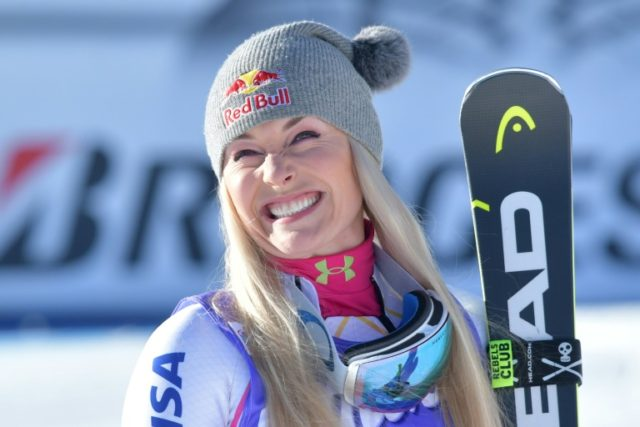 Winner Lindsey Vonn from the USA celebrates during the podium ceremony of the FIS Alpine World Cup Women's Downhill on January 20, 2018 in Cortina d'Ampezzo, Italian Alps