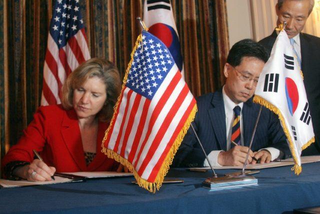 US Trade Representative Susan Schwab (L) and South Korean Trade Minister Kim Hyun-chong sign the KORUS Free Trade Agreement in June, 2007 in Washington, DC