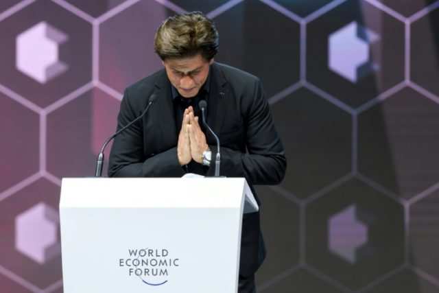 Bollywood actor Shah Rukh Khan after receiving an award in Davos for charitable work for victims of acide attacks