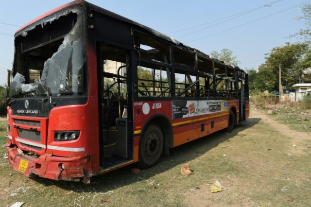 """The charred remains of a bus in the town of Sanand, some 30 km from Ahmedabad, which was torched by protesters against the film """"Padmaavat"""""""