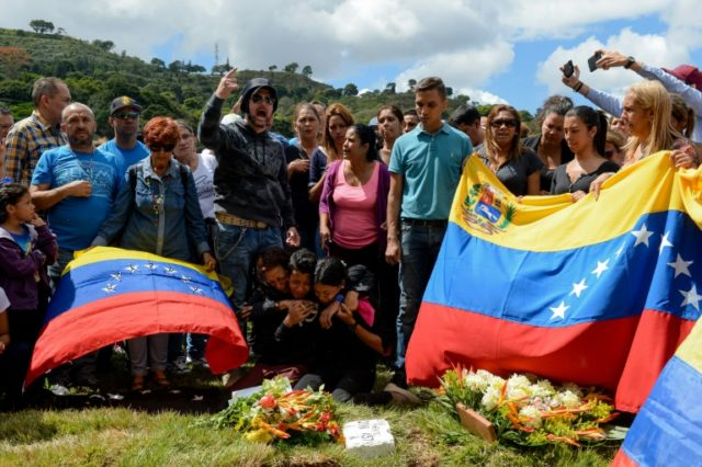 Relatives mourn the deaths of two dissidents gunned down during a bloody police operation in Venezuela