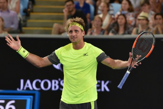 Tennys Sandgren of the US celebrates after defeating Switzerland's Stanislas Wawrinka in their Australian Open second round match, in Melbourne, on January 18, 2018