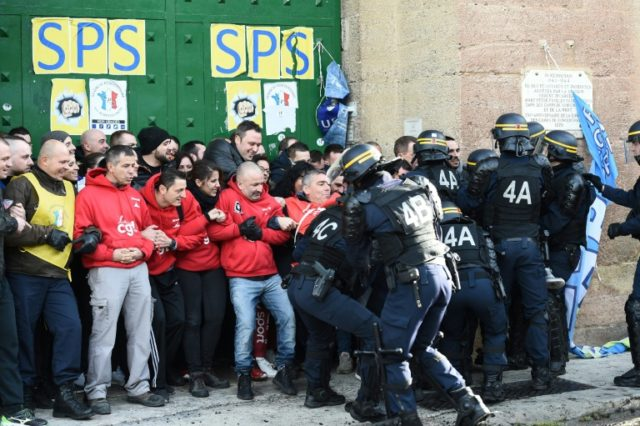 French riot police clash with striking prison guards blocking access to the Baumettes prison in Marseille on Monday