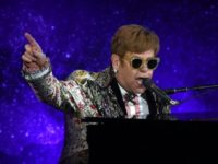 Pop legend Elton John performs two songs before announcing at a New York press conference that he is retiring from touring