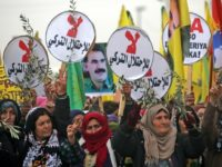 Syrian Kurds march to protest against the Turkish offensive