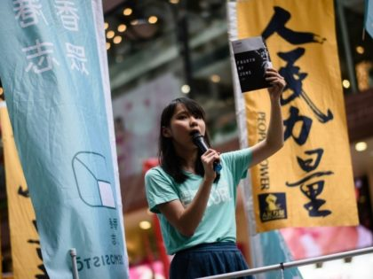Pro-democracy activist Agnes Chow addressing crowds in Hong Kong ahead of a candlelight vigil to mark the June 4 Tiananmen crackdown in Beijing in 1989