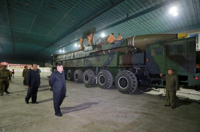 North Korean leader Kim Jong-Un inspecting the assembly work of an ICBM which was launched in 2017