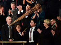 North Korean defector Ji Seong-ho raises his crutches as he is recognized by US President Donald Trump during the State of the Union address