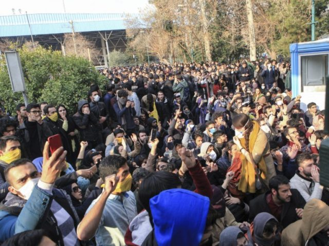 In this photo taken by an individual not employed by the Associated Press and obtained by the AP outside Iran, university students attend a protest inside Tehran University while anti-riot Iranian police prevent them to join other protestors, in Tehran, Iran, Saturday, Dec. 30, 2017. A wave of spontaneous protests …