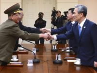 FILE - In this Aug. 22, 2015 file photo provided by the South Korean Unification Ministry, South Korean National Security Director, Kim Kwan-jin, right, and Unification Minister Hong Yong-pyo, second from right, shake hands with Hwang Pyong So, left, North Korea' top political officer for the Korean People's Army, and Kim Yang Gon, a senior North Korean official responsible for South Korean affairs, during their meeting at the border village of Panmunjom in Paju, South Korea. A Seoul official says both Koreas have agreed to hold their first talks in more than two years next Tuesday, Jan. 9, 2018.