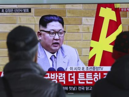 FILE - In this Jan. 1, 2018, file photo, South Koreans watch a TV news program showing North Korean leader Kim Jong Un's New Year's speech, at the Seoul Railway Station in Seoul, South Korea. On Jan. 1, 2018, Kim said in his New Year's address that he is willing …