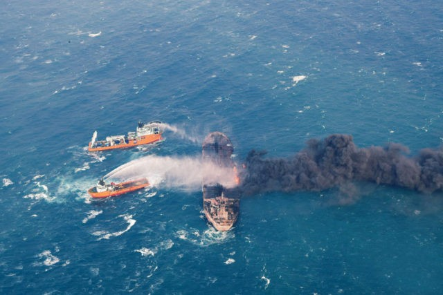 In this Wednesday, Jan. 10, 2018, photo provided by China's Ministry of Transport, firefighting boats work to put on a blaze on the oil tanker Sanchi in the East China Sea off the eastern coast of China. Rescue ships looking for missing crew members from the oil tanker Sanchi have …