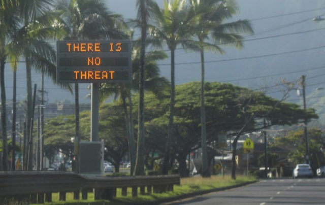 "This Saturday, Jan. 13, 2018, photo provided by Jhune Liwanag shows a highway median sign broadcasting a message of ""There is no threat"" in Kaneohe, Hawaii. State emergency officials mistakenly sent out an emergency alert warning of an imminent missile strike, sending islanders into a panic. (Jhune Liwanag via The …"