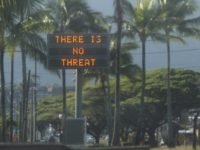 "This Saturday, Jan. 13, 2018, photo provided by Jhune Liwanag shows a highway median sign broadcasting a message of ""There is no threat"" in Kaneohe, Hawaii. State emergency officials mistakenly sent out an emergency alert warning of an imminent missile strike, sending islanders into a panic. (Jhune Liwanag via The AP)"