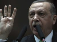 Turkey's President and leader of ruling Justice and Development Party Recep Tayyip Erdogan addresses his lawmakers at the parliament in Ankara, Turkey, Tuesday, Jan. 16, 2018. Erdogan on Tuesday called on NATO to take a stance against the United States, a fellow ally, over its plans to form a 30,000-strong …
