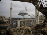 The reconstructed Khaled Bin al-Waleed Mosque is framed by a damaged building, in the old city of Homs, Syria, Wednesday, Jan. 17, 2018. It has been almost four years since the last remaining rebels and civilians withdrew from the remaining strongholds in the ancient heart of Homs in Syria. But few people have returned, and large parts of the once vibrant old city are still abandoned and destroyed, as if time had stood still since the guns fell silent. (AP Photo/Hassan Ammar)
