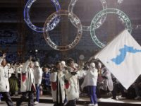 FILE - In this Feb. 10, 2006, file photo, Korea's flag-bearers Bora Lee and Jong-In Lee, carrying a unification flag lead their teams into the stadium during the 2006 Winter Olympics opening ceremony in Turin, Italy. When athletes of the rival Koreas walked together behind a single flag for the …