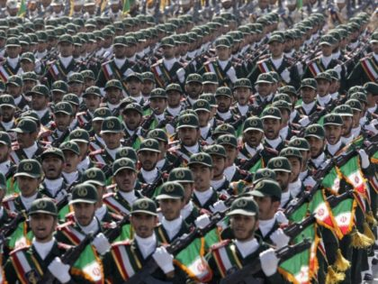 In this Sept. 21, 2012 photo, Iran's Revolutionary Guard troops march during a military parade commemorating the anniversary of start of the 1980-88 Iraq-Iran war, in front of the shrine of the late revolutionary founder Ayatollah Khomeini, just outside Tehran, Iran. Supreme Leader Ayatollah Ali Khamenei has ordered the Revolutionary …