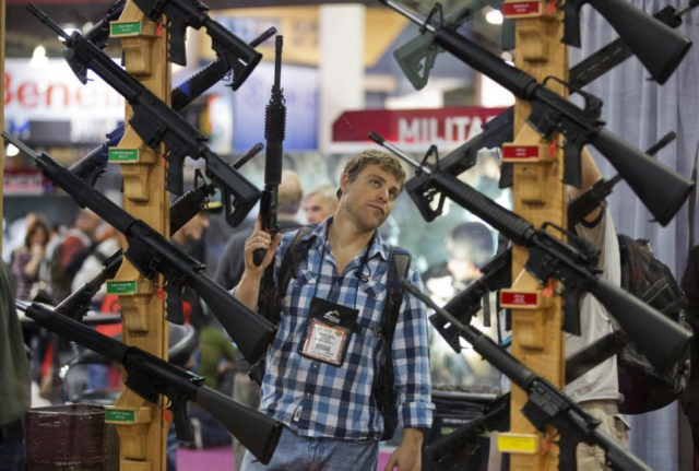 Gun industry gathers just a few miles from mass shooting