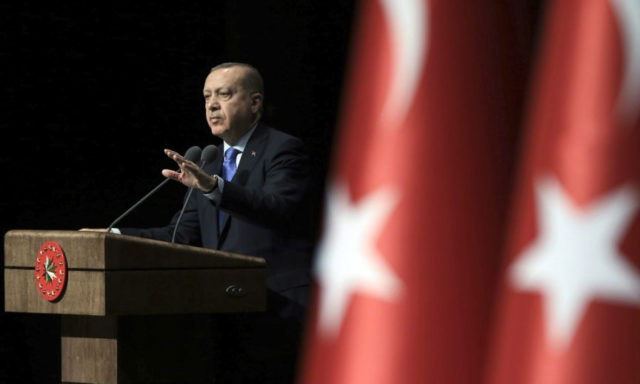 Turkey's President Recep Tayyip Erdogan addresses businessmen in Ankara, Turkey, Monday, Jan. 22, 2018. The Turkish offensive on Afrin, codenamed Operation Olive Branch, started on Saturday, heightening tensions in the already complicated Syrian conflict and threatening to further strain ties between NATO allies Turkey and the United States. (Murat Cetinmuhurdar/Pool …