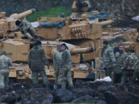 Turkish soldiers prepare their tanks to enter combat and join a military offensive on a Kurdish-held enclave in northern Syria, at a staging area in the Hatay province,Turkey near the the border with Syria.Turkey launched an operation, codenamed Olive Branch, last week against the Syrian Kurdish People's Protection Units in …